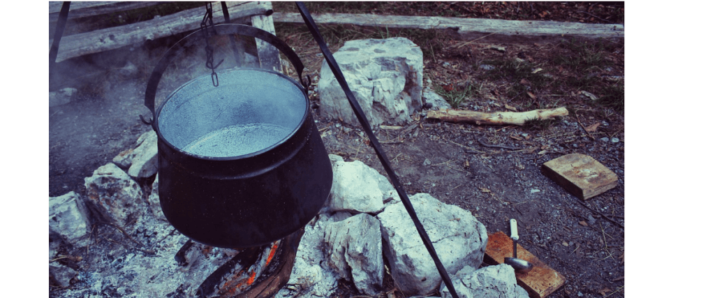 Cooking over an open fire on a camping journey