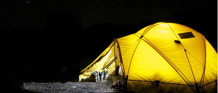 Camping tent set up near a lake