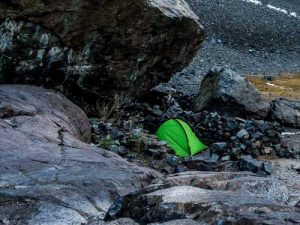 Tent placed behind wind break for calmer evening